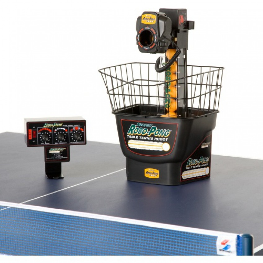 Robo-Pong-1040 with controller on a table tennis table